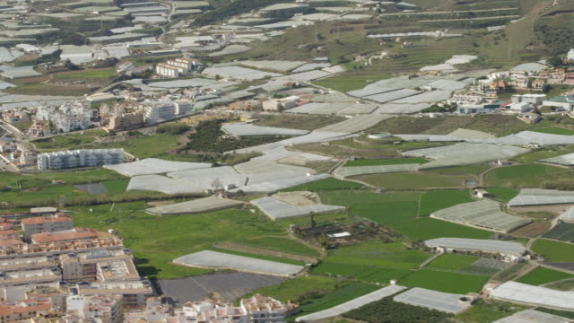 Aerial view of buildings and greenhouses in Malaga, Andalusia, Spain