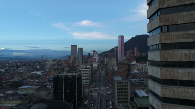 aerial view of buildings and street against sky in city, bogota, colombia - bogota stock videos & royalty-free footage