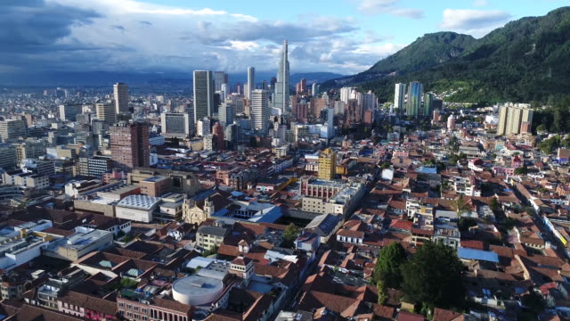 Aerial view of buildings and towers in city, Bogota, Colombia