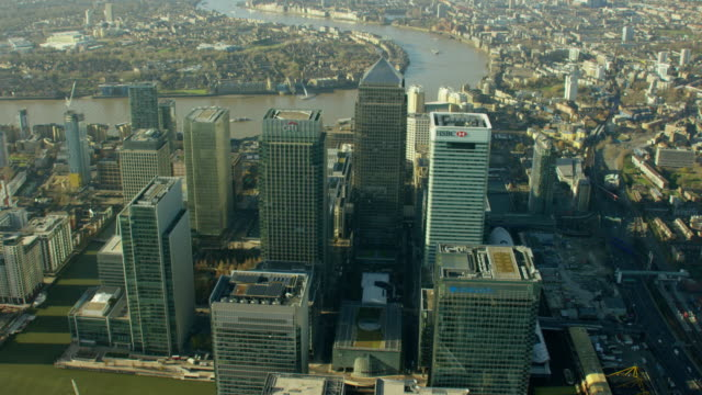 aerial view of buildings in canary wharf london - geographical locations stock videos & royalty-free footage