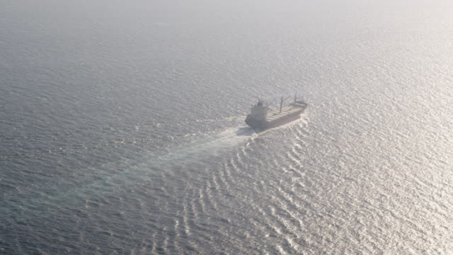 aerial view of bulk carrier steaming into the sun in the Atlantic Ocean