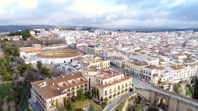 stockvideo's en b-roll-footage met aerial view of bullfight plaza and puente nuevo bridge, ronda in spain - puente