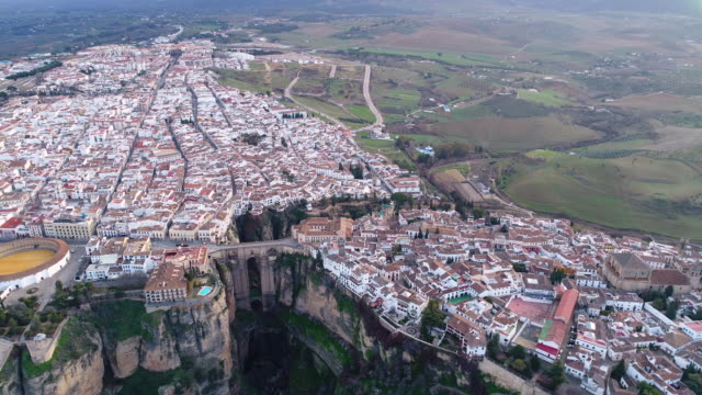 Aerial view of bullfight plaza and Puente Nuevo Bridge, Ronda in Spain