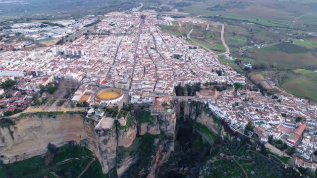 aerial view of bullfight plaza and puente nuevo bridge, ronda in spain - puente bildbanksvideor och videomaterial från bakom kulisserna