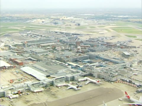 aerial view of busy airport terminal at heathrow. ntsc, pal - heathrow airport stock videos and b-roll footage