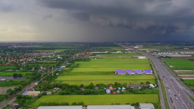 aerial view of busy freeway with storm in bangkok thailand - dramatic sky stock videos & royalty-free footage