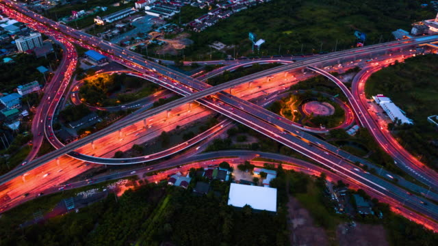 vídeos de stock e filmes b-roll de aerial view of busy highway in bangkok at night,hyperlapse - eléctrico