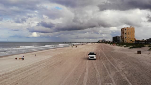 aerial view of busy jacksonville beach during covid-19 pandemic, jacksonville, florida, united states of america, north america - jacksonville florida video stock e b–roll