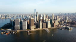 Aerial view of busy New York city in America, Manhattan district on the shore of East river. Drone flies to city centre