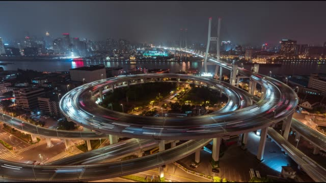 t/l ws ha pan aerial view of busy overpass in shanghai at night, nanpu bridge - complexity stock videos and b-roll footage