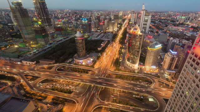 T/L Aerial View of Busy Road Intersection, Dusk to Night Transition / Beijing, China