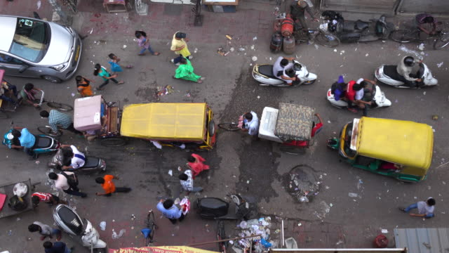 aerial view of busy street in delhi, india - india video stock e b–roll