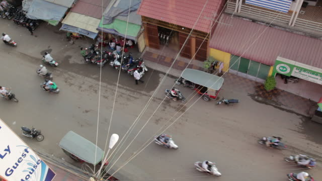aerial view of busy street in phnom penh, cambodia - phnom penh stock videos and b-roll footage