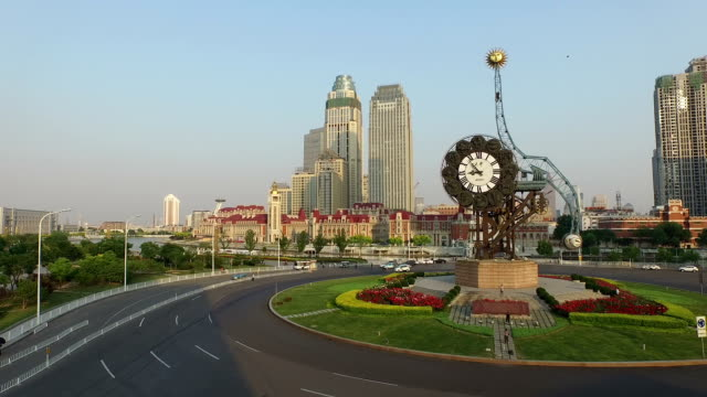 Aerial view of busy traffic circle and pedestrian walking in tianjin.