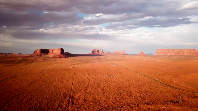 4k aerial view of buttes near monument valley national park - canyon stock videos & royalty-free footage