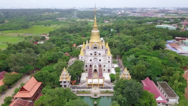 aerial view of buu long pagoda in ho chi minh city. a beautiful buddhist temple hidden away in ho chi minh city at vietnam - pagoda stock videos & royalty-free footage