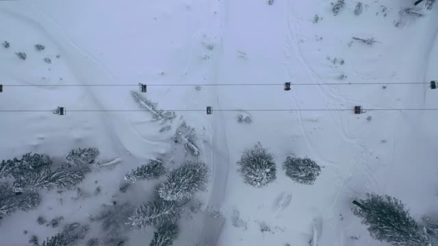 aerial view of cable car in carpathian mountains in winter - cable car stock videos & royalty-free footage