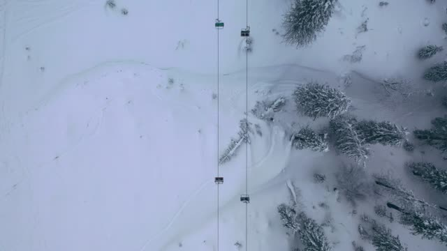 aerial view of cable car in carpathian mountains in winter - overhead cable car stock videos & royalty-free footage