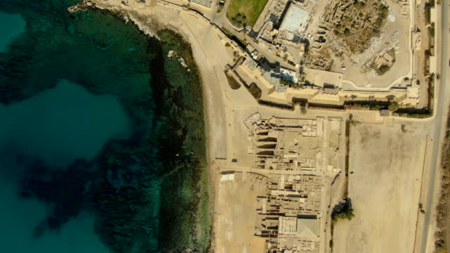 aerial view of caesarea archaeological site - and it's coastline - 地中海点の映像素材/bロール