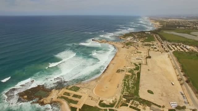 aerial view of caesarea archaeological site - ruins of the ancient port and hippodrome - caesarea stock videos & royalty-free footage