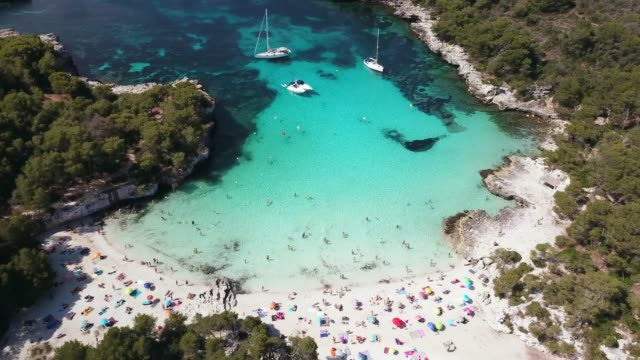 aerial view of cala en turqueta crowded with people, menorca - minorca stock videos & royalty-free footage
