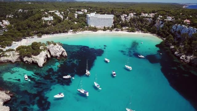 aerial view of cala galdana in summer, menorca, spain - mediterranean sea stock videos & royalty-free footage
