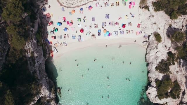 stockvideo's en b-roll-footage met aerial view of cala macarelleta beach in summer - zonwering