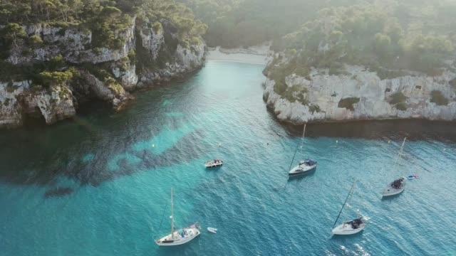 aerial view of cala macarelleta with boats, minorca, spain - minorca stock videos & royalty-free footage