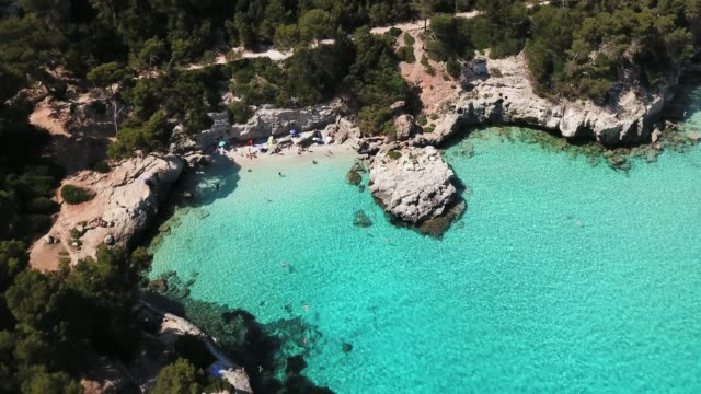 aerial view of cala mitjana beach with tourists, menorca, spain - bay of water stock videos & royalty-free footage