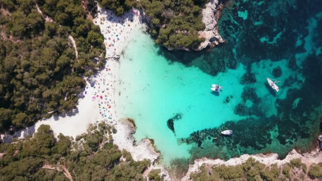 aerial view of cala turqueta beach crowded with people - minorca stock videos & royalty-free footage