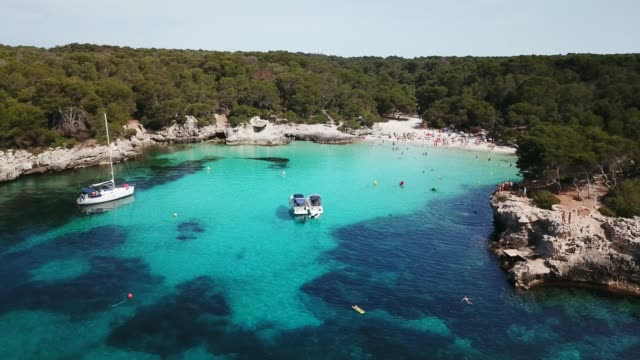aerial view of cala turqueta beach crowded with people - balearic islands stock videos and b-roll footage