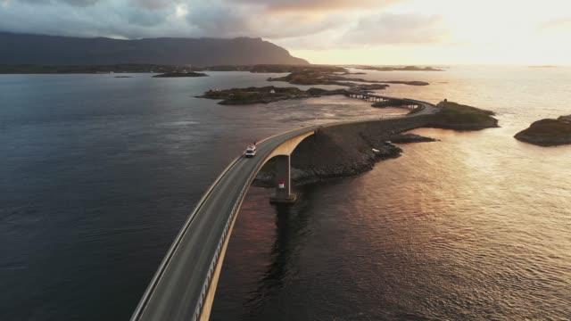 aerial view of camper van on  atlantic road  at sunset - land vehicle stock videos & royalty-free footage