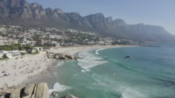 4K aerial view of Camps Bay Beach with the 12 Apostles mountains in the background, Cape Town,South Africa