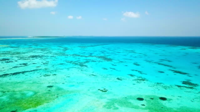 aerial view of canareef resort maldives, herathera island, addu atoll - maldives stock videos & royalty-free footage