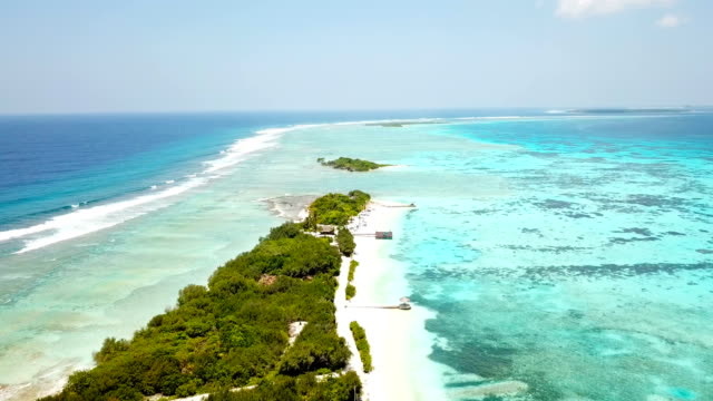 aerial view of canareef resort maldives, herathera island, addu atoll - tourist resort stock videos and b-roll footage
