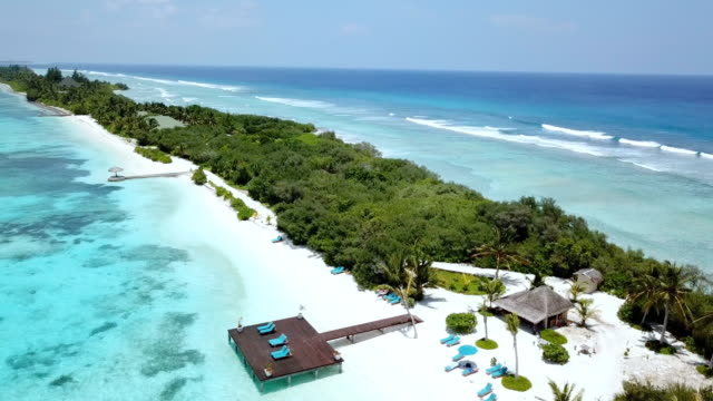 aerial view of canareef resort maldives, herathera island, addu atoll - idyllic video stock e b–roll