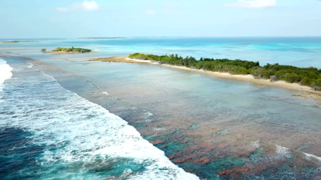 aerial view of canareef resort maldives, herathera island, addu atoll - indian ocean stock videos & royalty-free footage