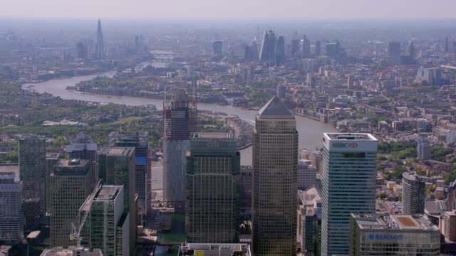 aerial view of canary wharf and central london, uk. 4k - canary wharf stock videos & royalty-free footage