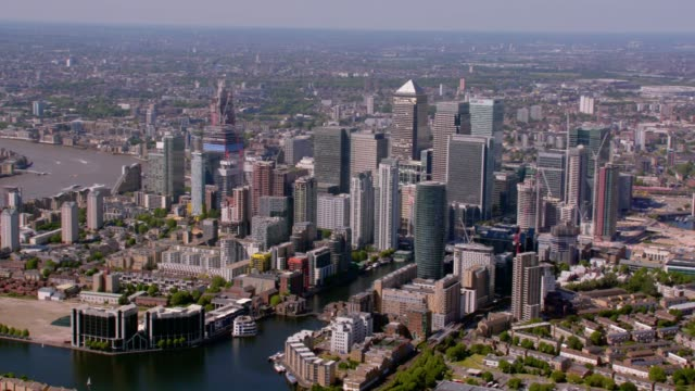 aerial view of canary wharf and east london, uk. 4k - east london stock videos and b-roll footage