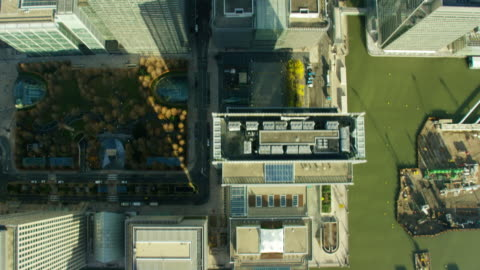 aerial view of canary wharf and river thames - hd format stock-videos und b-roll-filmmaterial
