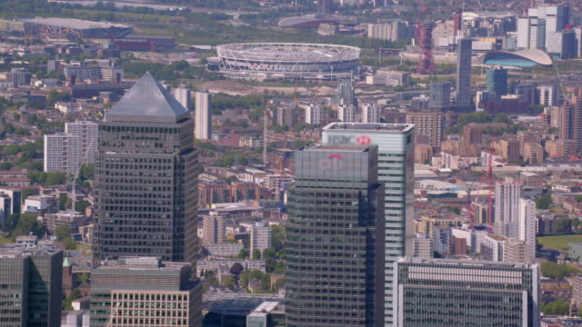 Aerial View of Canary Wharf and the Olympic Stadium London, UK. 4K