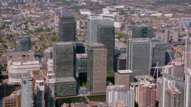 aerial view of canary wharf in london, uk. 4k - canary wharf stock videos & royalty-free footage