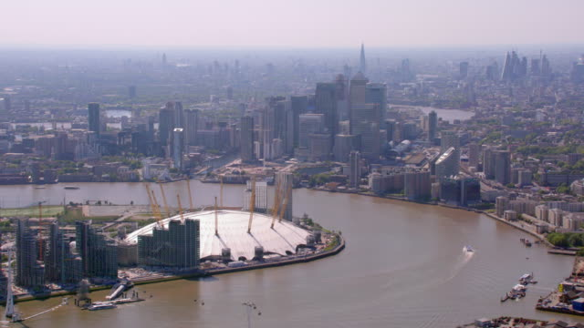 aerial view of canary wharf, london, uk. 4k - international landmark stock videos & royalty-free footage