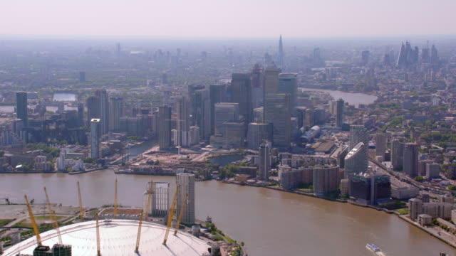 aerial view of canary wharf, london, uk. 4k - the o2 england stock videos & royalty-free footage
