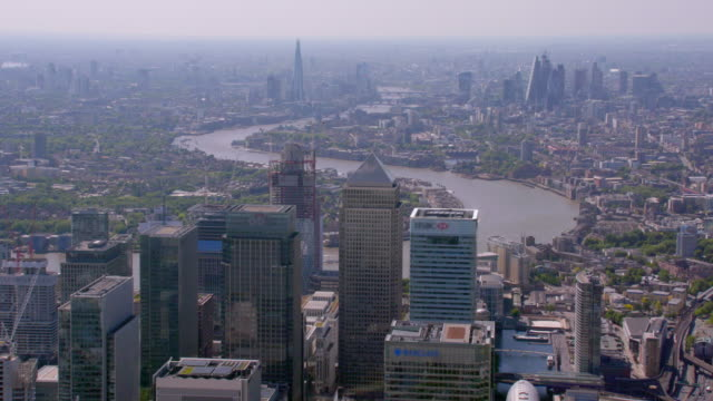aerial view of canary wharf, london, uk. 4k - london england stock videos & royalty-free footage