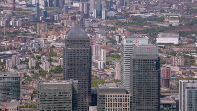 aerial view of canary wharf, london, uk. 4k - canary wharf stock videos & royalty-free footage