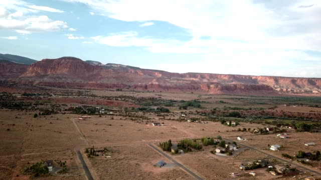 4k aerial view of canyons near capitol reef - red rocks stock videos & royalty-free footage