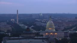 Aerial view of Capitol Dome and Library of Congress at dusk.