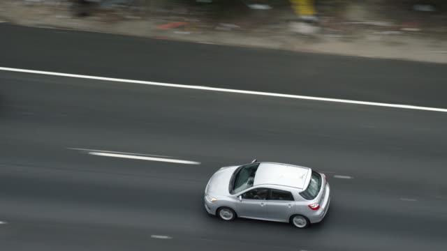 MS TS Aerial view of car driving on highway
