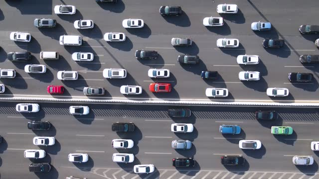 aerial view of car driving on road - traffic jam stock videos & royalty-free footage